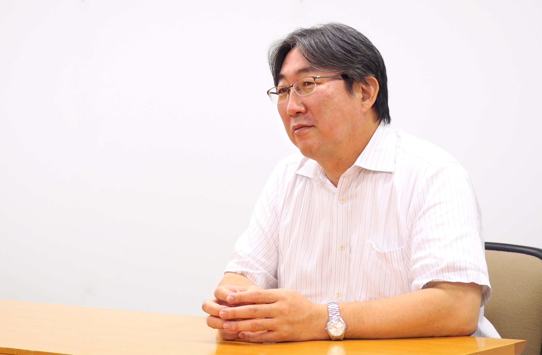 SIソリューション事業部 冨岡 正俊